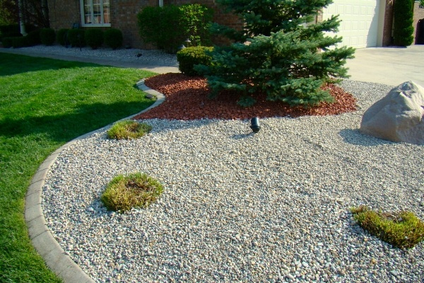 A landscape bed filled with pea gravel.