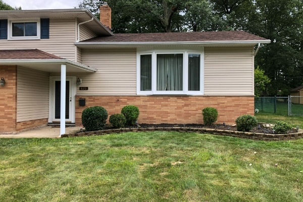 A home with a freshly mowed lawn and fresh mulch in the landscape beds